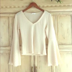 Top with v-neck and bell sleeves